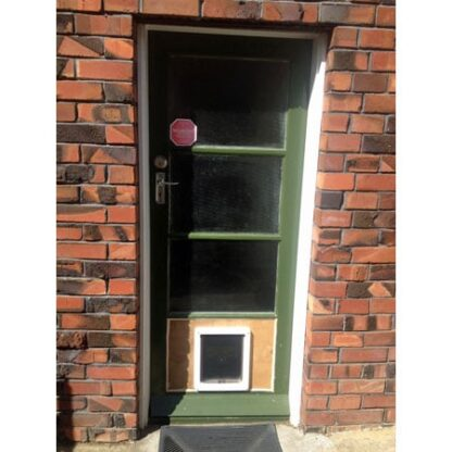 Dog Mate medium dog door (white) installed in plywood, replacing glass panel