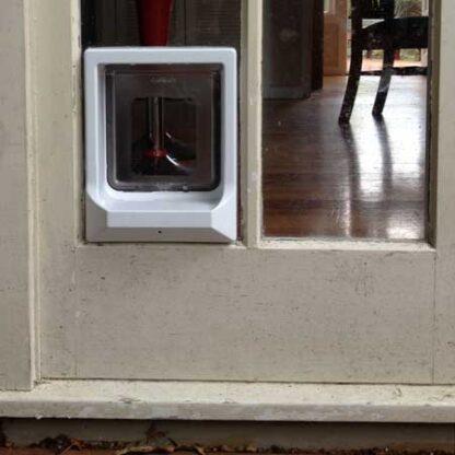 Catwalk W-UCDW upgradeable cat door (white) installed in glass